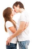 Tender kiss of young couple Royalty Free Stock Images