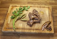 Lamb meet chops on the cutting board royalty free stock image