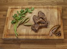 Lamb meet ribs on the cutting board stock photos