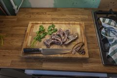 Lamb meet ribs on the cutting board stock images
