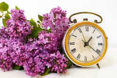 Spring decoration of lilac blossom, old watch dial on white background. Tender lilac blossom, old watch dial on white background Stock Photos