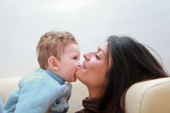 Tender look. Mother and son looking tenderly into his eyes Royalty Free Stock Photo