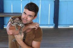 Tender man holding baby wild feline.  stock photography