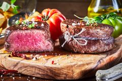 Tender medium rare beef fillet steak medallions stock image
