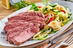 Tender medium rare roast beef with salad Royalty Free Stock Image