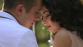 Tender moment of attractive young couple in love lovingly look at each other close up.  stock video