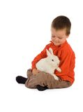 Tender moment with a bunny. Young boy having a tender moment with his bunny (easter theme, isolated stock photography