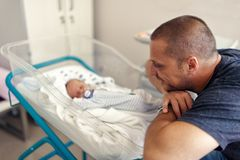 Tender moment between a father and his newborn baby stock photos