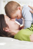 Tender moments: Joyful mother embracing her son with love. Royalty Free Stock Photography