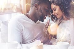 African male person touching forehead of his girl stock photography