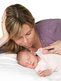 Tender mother. Loving mother watching her sleeping 18 days old baby Stock Photos