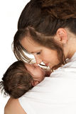 Tender mother and baby. Young mother in a moment of tenderness with her 19 days old baby Stock Photo