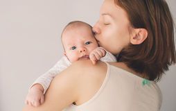 Tender mother and cute baby at home Stock Image