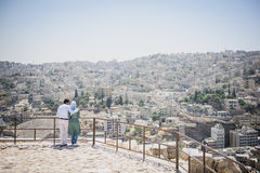 Tender muslim couple looking at panorama of Amman Royalty Free Stock Images