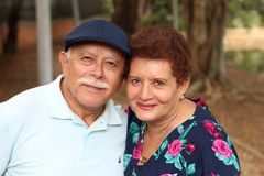 Tender older ethnic couple candid stock image