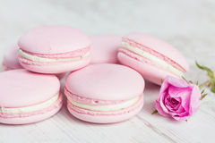 Tender pink macaroons on white wood background Royalty Free Stock Photos