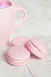 Tender pink macaroons on white wood background Stock Photography