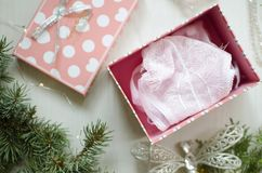 Tender pink underwear on the white background. Christmas women& x27;s Stock Photos