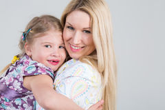 Tender portrait of mother and daughter. Hugging in the studio stock images