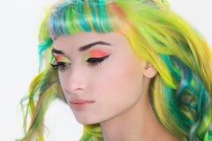 A Tender Portrait Of A Rainbow Girl. A Tender Portrait Of A Rainbow hair Girl and colorful make up stock photo