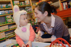 Tender portrait woman mother kid disguised as bunny Royalty Free Stock Photos