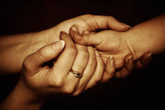 Tender protection. Child�s hand in female hands, together in tender protective gesture royalty free stock images