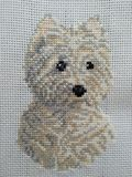 Tender puppy embroidered to cross stitch stock photos