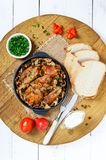 Tender rabbit meat with forest mushrooms. A dietary dish. Royalty Free Stock Photo
