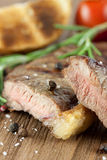 Tender roast beef. On a wooden board Stock Images