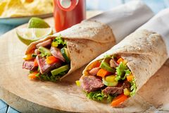 Tender roasted entrecote beef steak wraps royalty free stock images