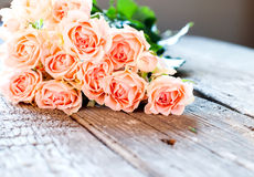 Tender Roses on Wooden Table in Sunlights Stock Photography