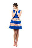 Tender sad feminine beauty in blue summer dress looking down with head on hands Royalty Free Stock Images