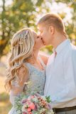 Tender and sensual kiss of the bride and groom on wedding day, the girl in a luxurious elegant dress with transparent stock photos