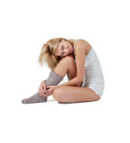 Tender sitting woman in lingerie and wool socks Stock Photo