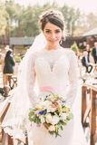 Tender smiling bride with beautiful bouquet Royalty Free Stock Image
