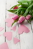 Tender spring tulips with pink paper hearts Royalty Free Stock Photos
