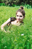 Tender teen in grass Stock Image
