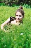 Tender teen in grass Stock Image