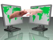 TENDER TOUCH. A man's hand and woman's hand touching each other and world map on computer Stock Photography