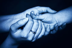 Tender touch. Child�s hand and female hands in tender protective gesture royalty free stock photos