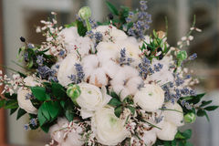 Tender wedding bouquet of roses, buttercup, lavender and cotton Stock Image