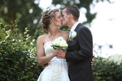 Tender wedding kiss. Young couple is kissing each other after wedding. wedding kiss Royalty Free Stock Photos