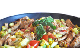 Tender wheat with chicken. Sweetcorn, courgette and pepper royalty free stock photography