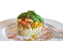 Tender wheat with chicken. Sweetcorn, courgette and pepper royalty free stock images