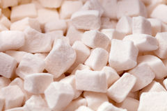 Tender white marshmallow pieces background. A sweet pile of marshmallow for background Royalty Free Stock Photography