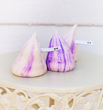 Tender white and violet meringues. With card for text Stock Images