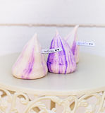 Tender white and violet meringues. With a text card Stock Photos