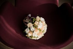 Tender white wedding bouquet made of white roses isolated on a purple background. Tender white wedding bouquet made of beautiful white roses isolated on a purple Stock Photography