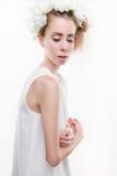 Tender woman. Beautiful tender woman wearing headpiece and white dress Stock Image