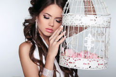 Tender Woman holding vintage bird cage isolated on grey backgrou Stock Photos